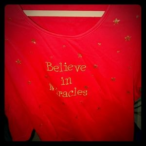 Red shirt with gold lettering and stars